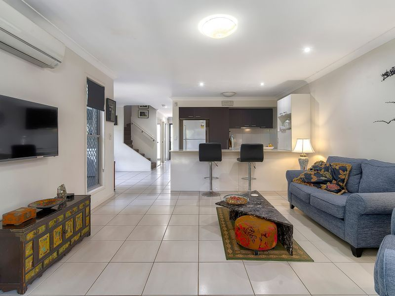 An exciting opportunity to purchase this rare corner position townhouse with a large entertainers courtyard with two car parks!